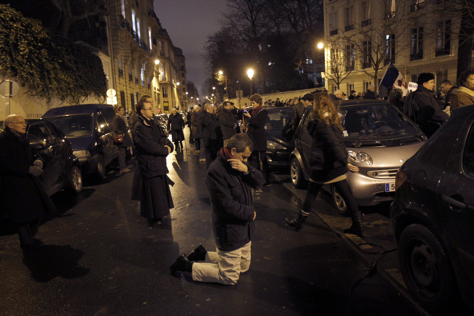 An opponent of gay marriage prays during a demonstration in Paris, Tuesday, Jan. 29, 2013.  The French government has presented a plan for debate in Parliament to legalize gay marriage and adoption. (AP Photo/Christophe Ena)