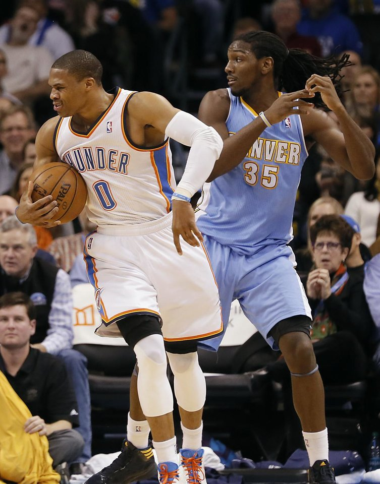 Photo - Oklahoma City's Russell Westbrook (0) reacts after being fouled by Denver's Kenneth Faried (35) during the NBA basketball game between the Oklahoma City Thunder and the Denver Nuggets at the Chesapeake Energy Arena on Wednesday, Jan. 16, 2013, in Oklahoma City, Okla.  Photo by Chris Landsberger, The Oklahoman
