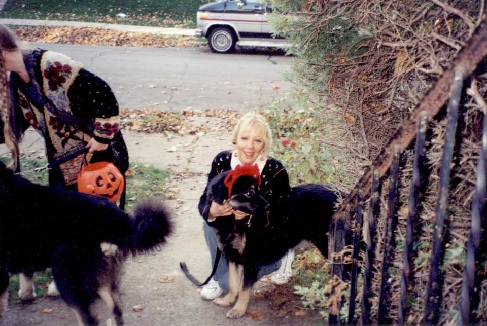 Photo - In this undated photo provided by Jane Flint, taken around Halloween in Milwaukee, Kong, a Tibetan Mastiff, poses for a photo with his owner Jane Flint. Kong and another Tibetan Mastiff named Pogo were shot and killed by Milwaukee police officers while they were executing a search warrant. The majority of shootings in most U.S. police departments involve animals, usually dogs, and experts say a new series of videos can help change often quick-trigger decisions fueled by fear. (AP Photo/Courtesy Jane Flint)