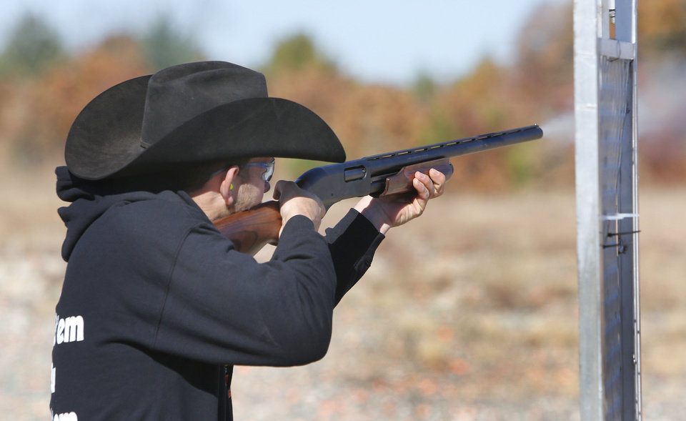 Photo - Erick High School senior Garrett Robertson competes in the FFA State Shooting Championship at the Oklahoma City Gun Club, Wednesday November 13, 2013. Photo By Steve Gooch, The Oklahoman