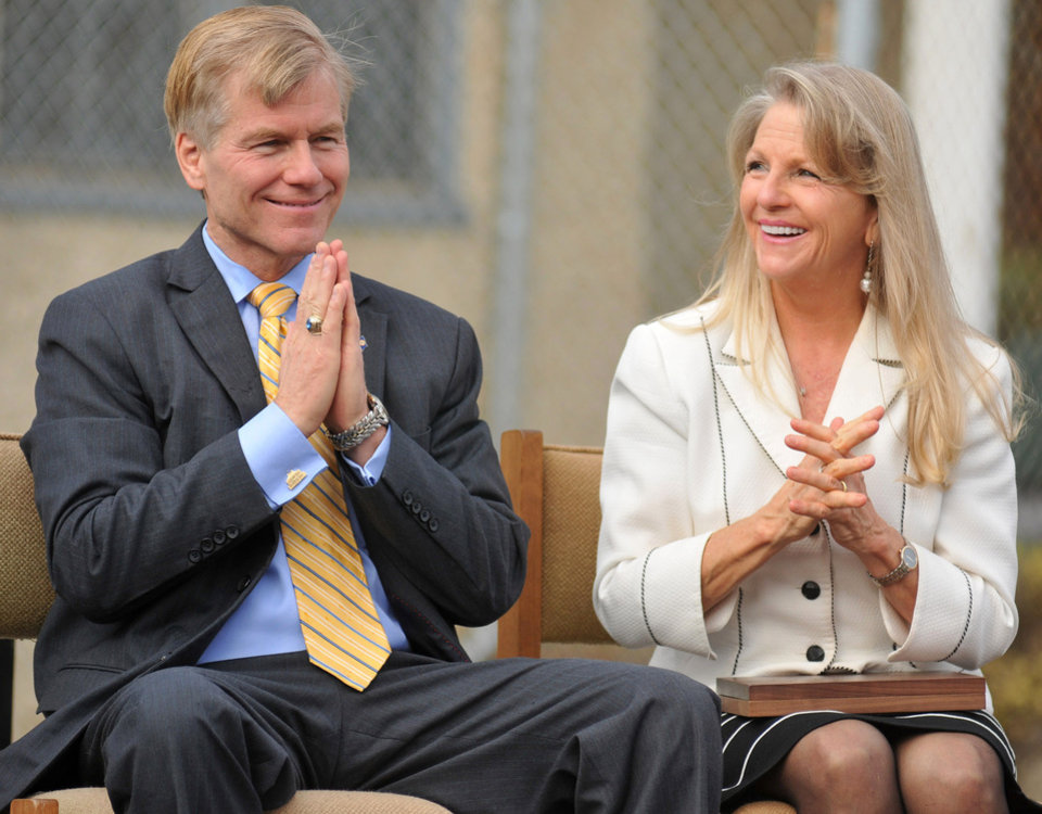 Photo - FILE - In this Oct. 22, 2013 file photo, then Virginia Gov. Bob McDonnell and First Lady Maureen McDonnell clasp their hands during an event at Saint Joseph School in Petersburg, Va. McDonnell and his wife were indicted Tuesday, Jan. 21, 2014, on corruption charges after a monthslong federal investigation into gifts the Republican received from a political donor. (AP Photo/The Progress-Index, Patrick Kane, File)