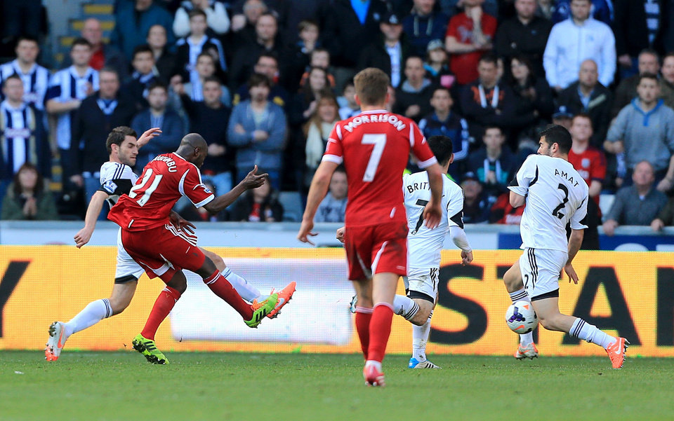 Photo - West Bromwich Albion's Youssouf Mulumbu, second left, shoots to score his team's second goal during their English Premier League soccer match against Swansea City at the Liberty Stadium, Swansea, Wales, Saturday, March 15, 2014. (AP Photo/Nick Potts, PA Wire)   UNITED KINGDOM OUT   -   NO SALES   -   NO ARCHIVES