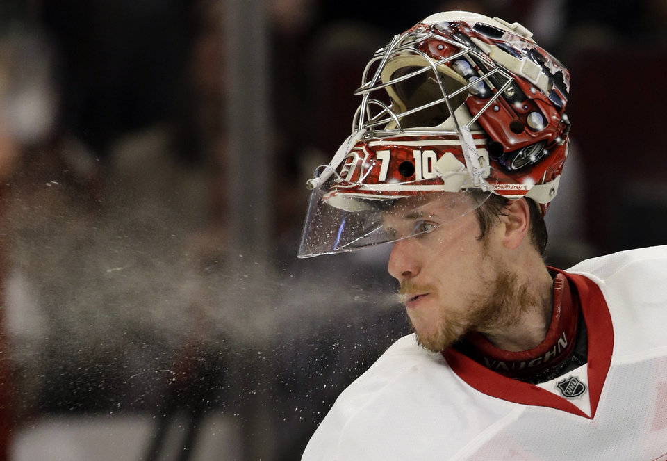 Photo - Detroit Red Wings goalie Jimmy Howard spits water during the second period of Game 1 of an NHL hockey playoffs Western Conference semifinal against the Chicago Blackhawks in Chicago, Wednesday, May 15, 2013. The Blackhawks won 4-1. (AP Photo/Nam Y. Huh)