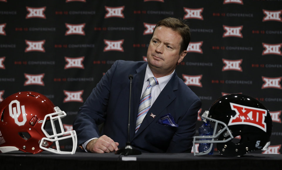 Photo - Oklahoma head coach Bob Stoops listens to a reporter's question during the Big 12 Conference NCAA college football media days in Dallas, Tuesday, July 22, 2014. (AP Photo)