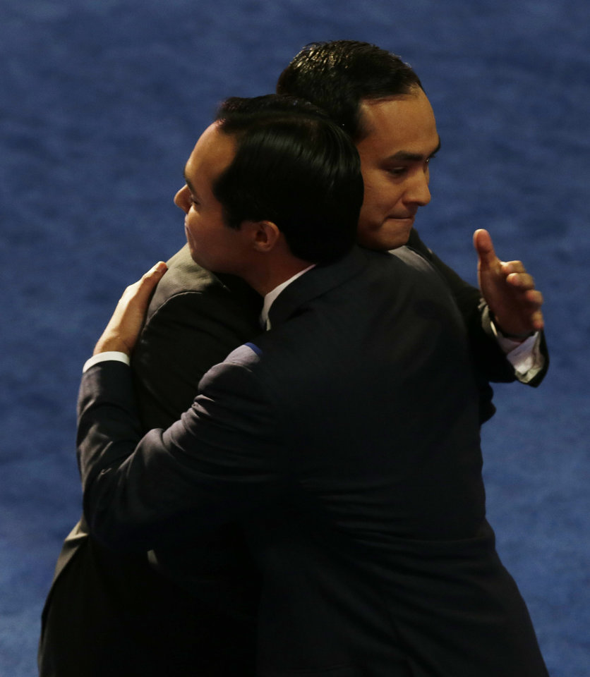 Photo - San Antonio Mayor Julian Castro, left, hugs his brother Joaquin Castro, San Antonio Mayor Julian Castro's brother, at the Democratic National Convention in Charlotte, N.C., on Tuesday, Sept. 4, 2012. (AP Photo/Charlie Neibergall)  ORG XMIT: DNC507