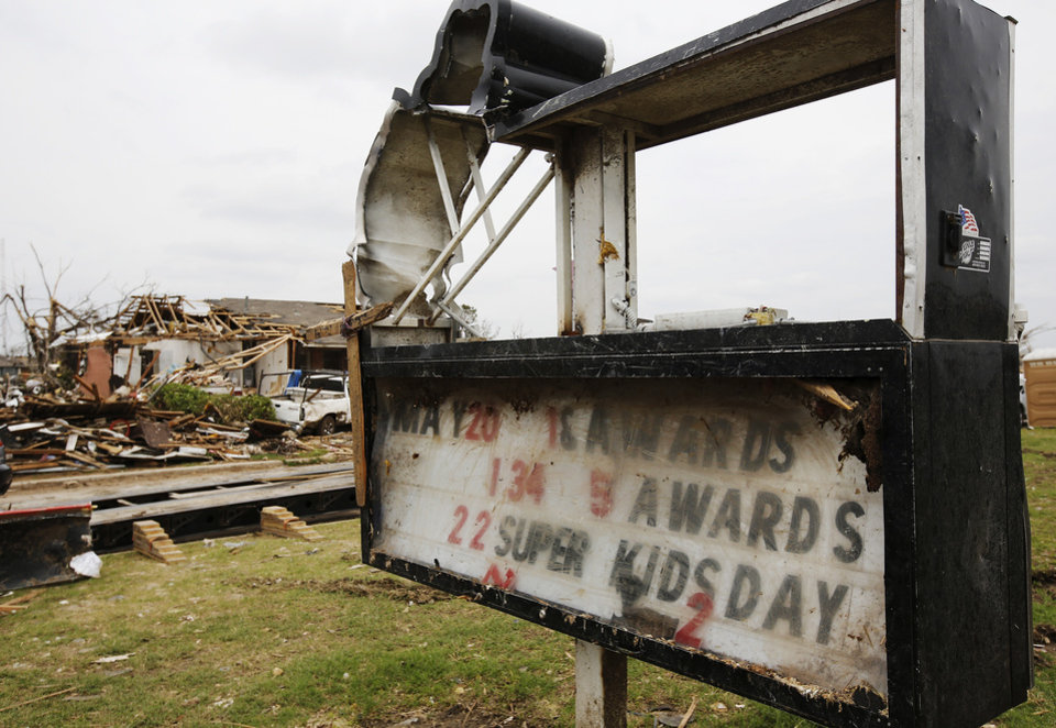 Destroyed sign and marquee in front of Plaza Towers Elementary School. Clean-up from last Monday's EF5 tornado continues in this neighborhood near SW 11 and Eagle Lane on Tuesday,  May 28, 2013.  Photo  by Jim Beckel, The Oklahoman.