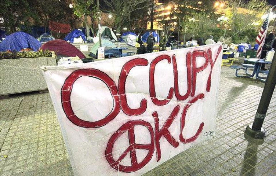 Photo - Occupy OKC camp in Kerr Park in Oklahoma City, Monday, November 28, 2011.     Oklahoma City Police threatened to arrest the protesters at 11 p.m. Monday.    Photo by David McDaniel, The Oklahoman