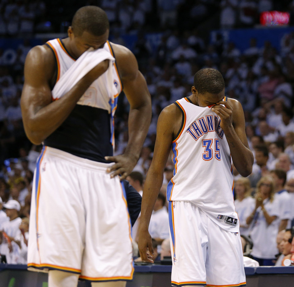 Photo - Oklahoma City's Serge Ibaka (9) and Kevin Durant (35) walk off the court during the final seconds of Oklahoma City loss in Game 6 of the Western Conference Finals in the NBA playoffs between the Oklahoma City Thunder and the San Antonio Spurs at Chesapeake Energy Arena in Oklahoma City, Saturday, May 31, 2014. Oklahoma City lost 112-107. Photo by Bryan Terry, The Oklahoman