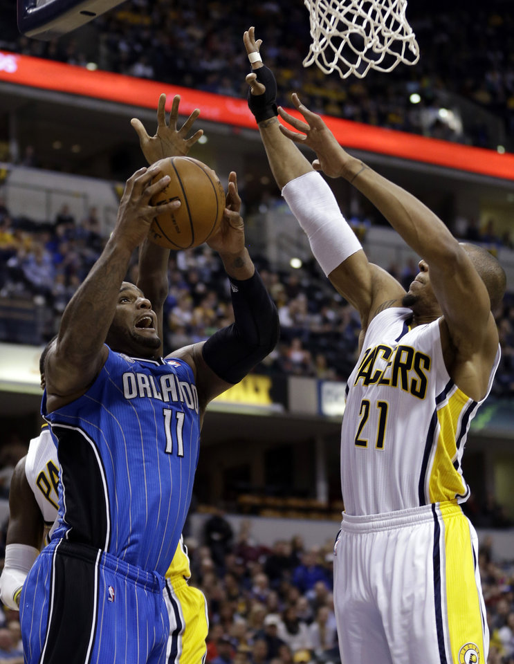 Photo - Orlando Magic forward Glen Davis, left, looks to shoot under Indiana Pacers forward David West in the first half of an NBA basketball game in Indianapolis, Monday, Feb. 3, 2014. (AP Photo/Michael Conroy)