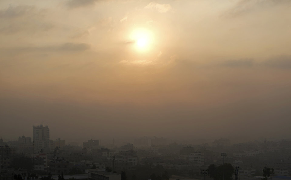 Photo - Smoke from Israeli strikes rises over Gaza City, in the Gaza Strip, Tuesday, July 22, 2014. A police spokesman said Israeli aircraft have hit dozens of targets in the Gaza Strip, including the home of the late leader of Hamas' military wing, sevenral mosques and a football stadium. (AP Photo/Khalil Hamra)
