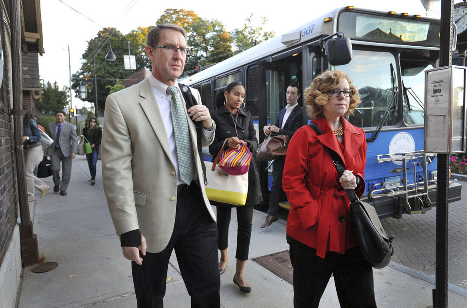 Commuters arrive by bus to the train station in Brewster, N.Y. to take the 7:14 a.m. train to Grand Central Station in New York. A power failure on the rail line in the Stamford, Conn., area Wednesday disrupted travel for tens of thousands of commuters heading into the city. (AP Photo/Danbury news-Times, Carol Kaliff)