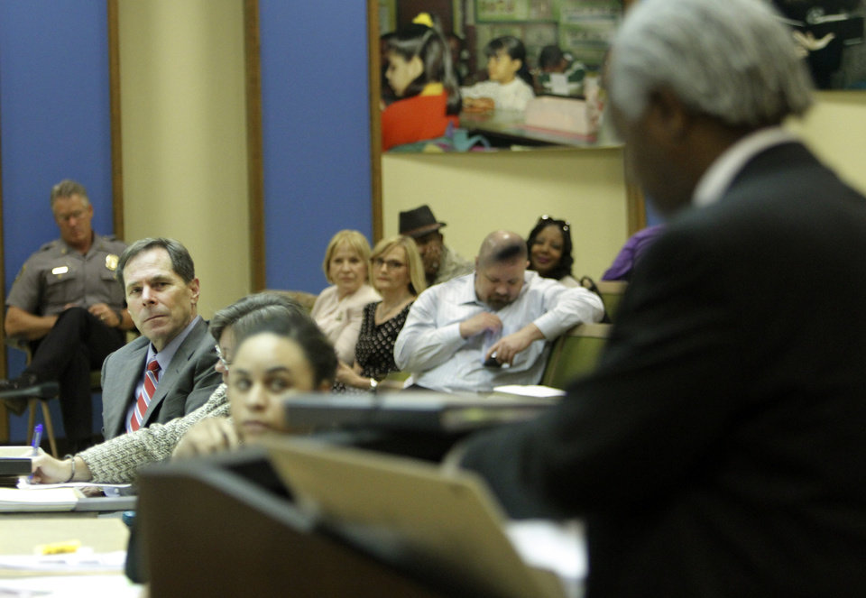 Photo - Oklahoma City Schools Superintendent Karl Springer watches on as Kwame Mumina, attorney representing Marcus Garvey Leadership Academy, addresses  the Oklahoma City School Board on May 28, 2013. Photo by KT King, The Oklahoman