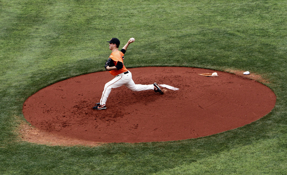 Photo - Oklahoma State's Vince Wheeland throw a pitch during the Bedlam baseball game between the University of Oklahoma and Oklahoma State University at the Chickasaw Bricktown Ballpark in Oklahoma City, Sunday, May 6, 2012. Photo by Sarah Phipps, The Oklahoman