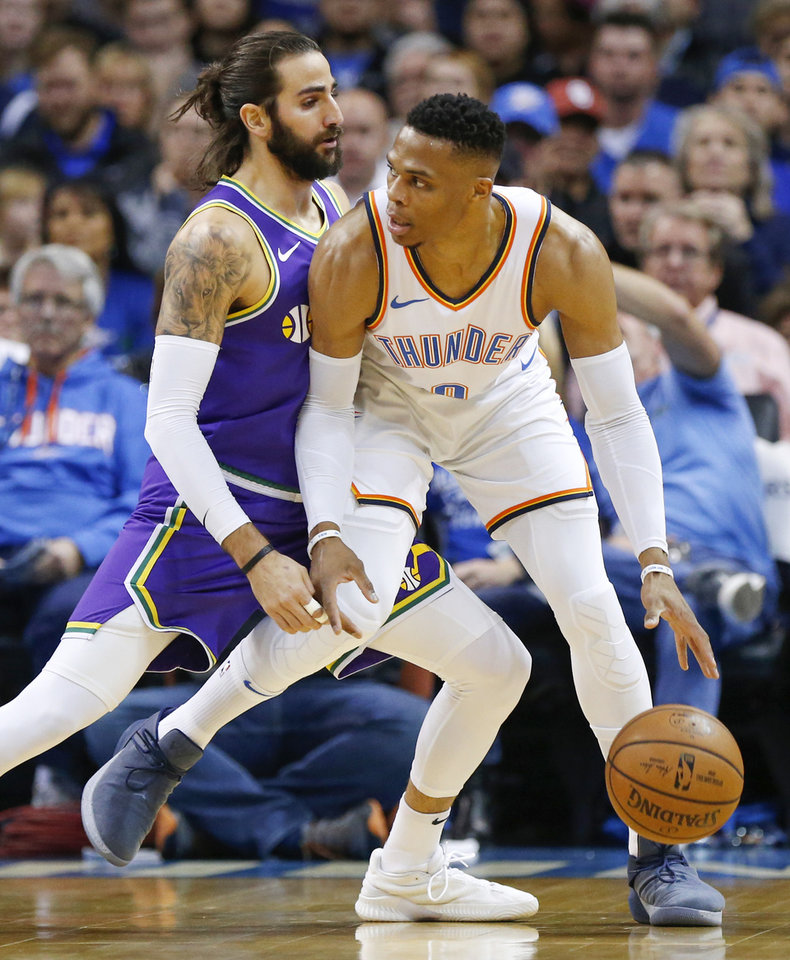 Photo - Oklahoma City's Russell Westbrook (0) works against Utah's Ricky Rubio (3) during an NBA basketball game between the Utah Jazz and the Oklahoma City Thunder at Chesapeake Energy Arena in Oklahoma City, Monday, Dec. 10, 2018. Photo by Nate Billings, The Oklahoman