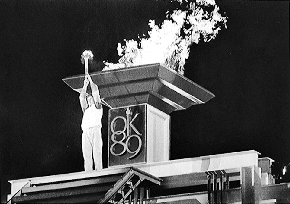 Photo - Olympian John Smith lights the torch at the 1989 Olympic Festival. AP photo