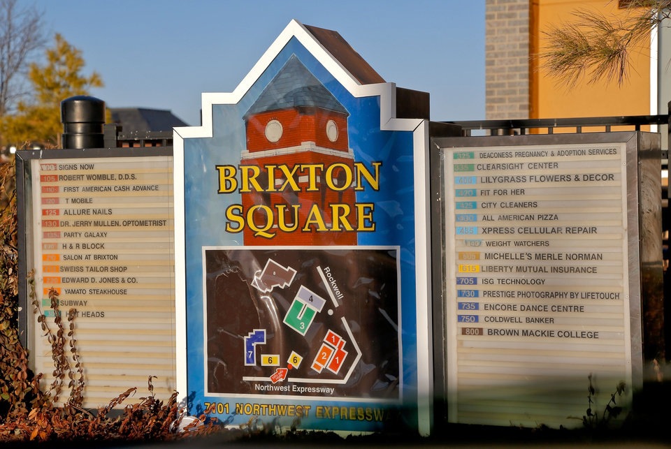 Photo - A map and legend shows the location of tenants at Brixton Square Shopping Center, which has new owners.  CHRIS LANDSBERGER - THE OKLAHOMAN