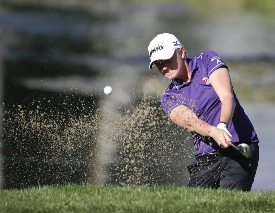 Photo - Stacy Lewis hits from a bunker on the 13th hole during the first round at the LPGA Kraft Nabisco Championship golf tournament Thursday, April 3, 2014, in Rancho Mirage, Calif. (AP Photo/Chris Carlson)