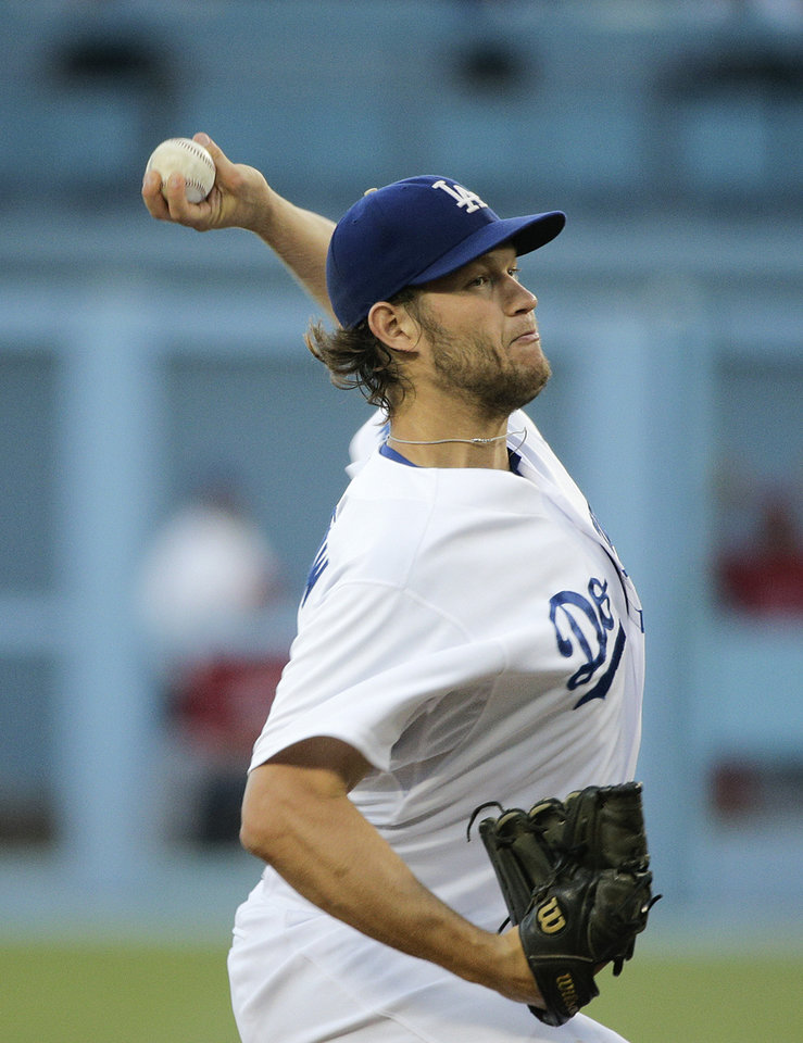 Photo - Los Angeles Dodgers starting pitcher Clayton Kershaw throws against the Los Angeles Angels during the first inning of a baseball game Tuesday, Aug. 5, 2014, in Los Angeles. (AP Photo/Jae C. Hong)
