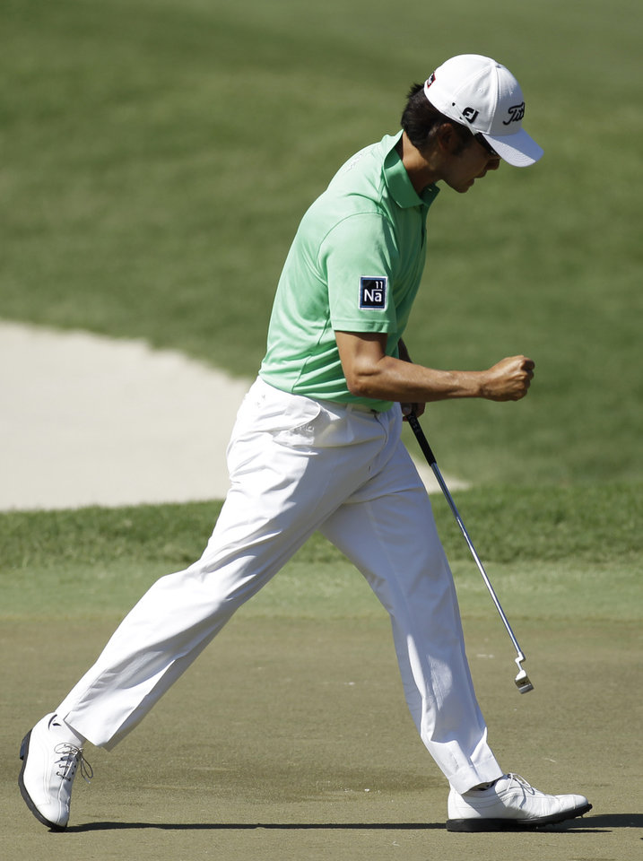 Photo -   Kevin Na gestures as makes birdie on the 11th hole during the second round of the Players Championship golf tournament at TPC Sawgrass, Friday, May 11, 2012, in Ponte Vedra Beach, Fla. (AP Photo/Chris O'Meara)
