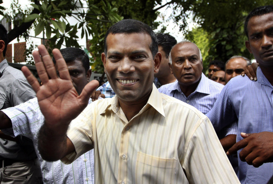 FILE - In this Feb. 10, 2012 file photo, Maldives\' former President Mohamed Nasheed waves as he walks back home after prayers in Male, Maldives. Police in the Maldives arrested Nasheed on Monday, Oct. 8, 2012, after he twice failed to appear before a court to face charges that he illegally ordered the arrest of a judge while in office. (AP Photo/Sinan Hussain, File)
