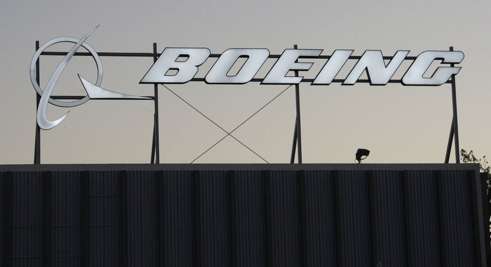 Photo -   The Boeing Company building and logo are seen in El Segundo, Calif., Tuesday, Jan. 25, 2011. Boeing Co. said Wednesday, Jan. 26, delays to its new 787 and higher pension expenses will hurt its 2011 profit. The airplane builder and defense company also says its fourth-quarter profit fell to $1.16 billion, down 8 percent from the same time last year. (AP Photo/Reed Saxon)