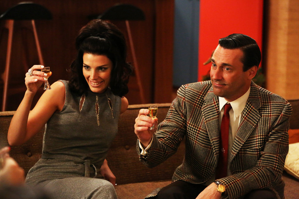 "This publicity photo provided by AMC shows Jessica Pare as Megan Draper, left, and Jon Hamm as Don Draper in a scene of ""Mad Men,"" Season 6, Episode 2. �Mad Men� returns for its sixth season Sunday, April 7, 2013. (AP Photo/AMC, Michael Yarish)"