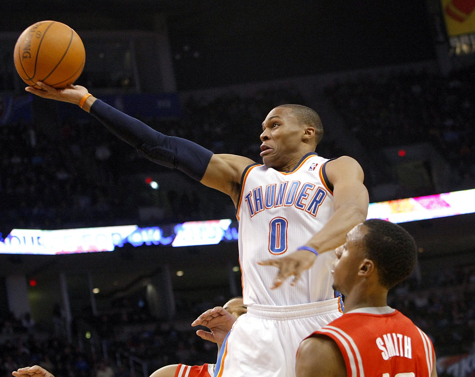 Photo - Oklahoma City's Russell Westbrook puts up a shot in front of Houston's Ish Smith during their NBA basketball game at the OKC Arena in downtown Oklahoma City on Wednesday, Nov. 17, 2010. Photo by John Clanton, The Oklahoman