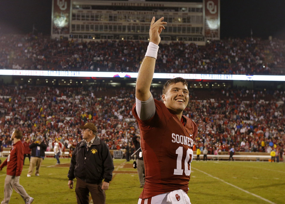 Oklahoma's Blake Bell (10) celebrates after a college football game between the University of Oklahoma Sooners (OU) and the Texas Tech Red Raiders at Gaylord Family-Oklahoma Memorial Stadium in Norman, Okla., on Saturday, Oct. 26, 2013. Oklahoma won 38-30. Photo by Bryan Terry, The Oklahoman