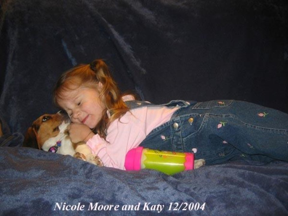 Community Photo By: Rebecca Jean Moore Submitted By: Nancy, KATY KISSES It was love at first sight when Katy and Nicole Moore first met. Nicole\'s mom is an amateur photographer as well as operating her