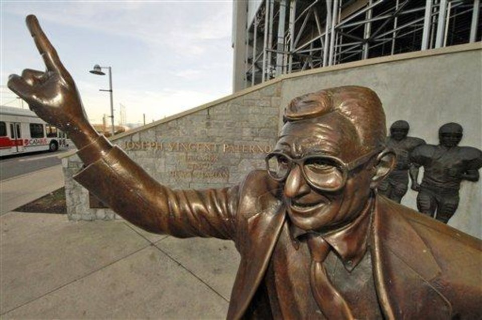 Photo - This is a statue of former Penn State University head football coach Joe Paterno outside Beaver Stadium on campus Monday, Dec. 12, 2011 in State College, Pa., Monday, Dec. 12, 2011. (AP Photo/Gene J. Puskar)