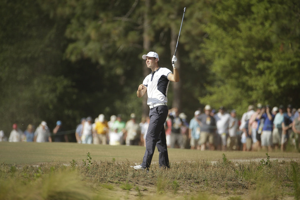Photo - Martin Kaymer, of Germany, hits from the natural area on the seventh hole during the final round of the U.S. Open golf tournament in Pinehurst, N.C., Sunday, June 15, 2014. (AP Photo/Charlie Riedel)