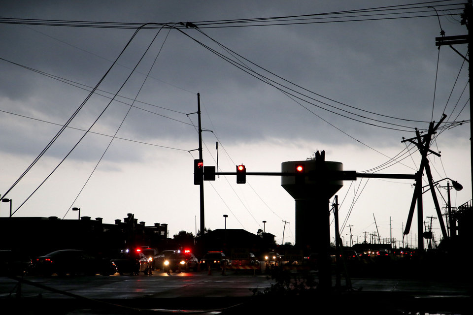 Photo - Utility lines block traffic at the corner of Tecumseh and 36th in Norman after storms moved through the area on Wednesday, May 6, 2015. Photo by Bryan Terry, The Oklahoman