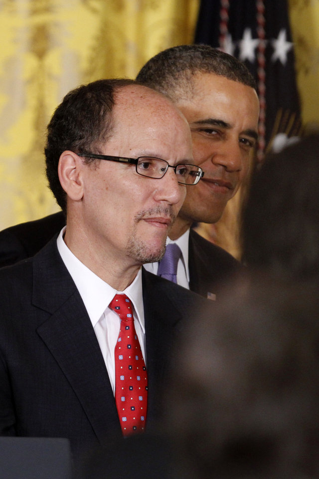 President Barack Obama and his nominee for Labor Secretary, Thomas E. Perez, leave the East Room of the White House in Washington, Monday March 18, 2013, after the president made the announcement.  (AP Photo/Jacquelyn Martin)
