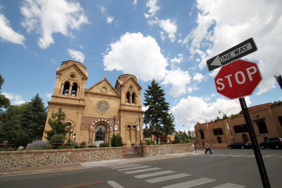Photo - This July 14, 2010 image shows St. Francis Cathedral, one of many historic churches and missions in Santa Fe, N.M. Aside from being one of the city's most photographed landmarks, Pope Benedict XVI in 2005 declared the cathedral the Southwest's cradle of Catholicism. (AP Photo/Susan Montoya Bryan)