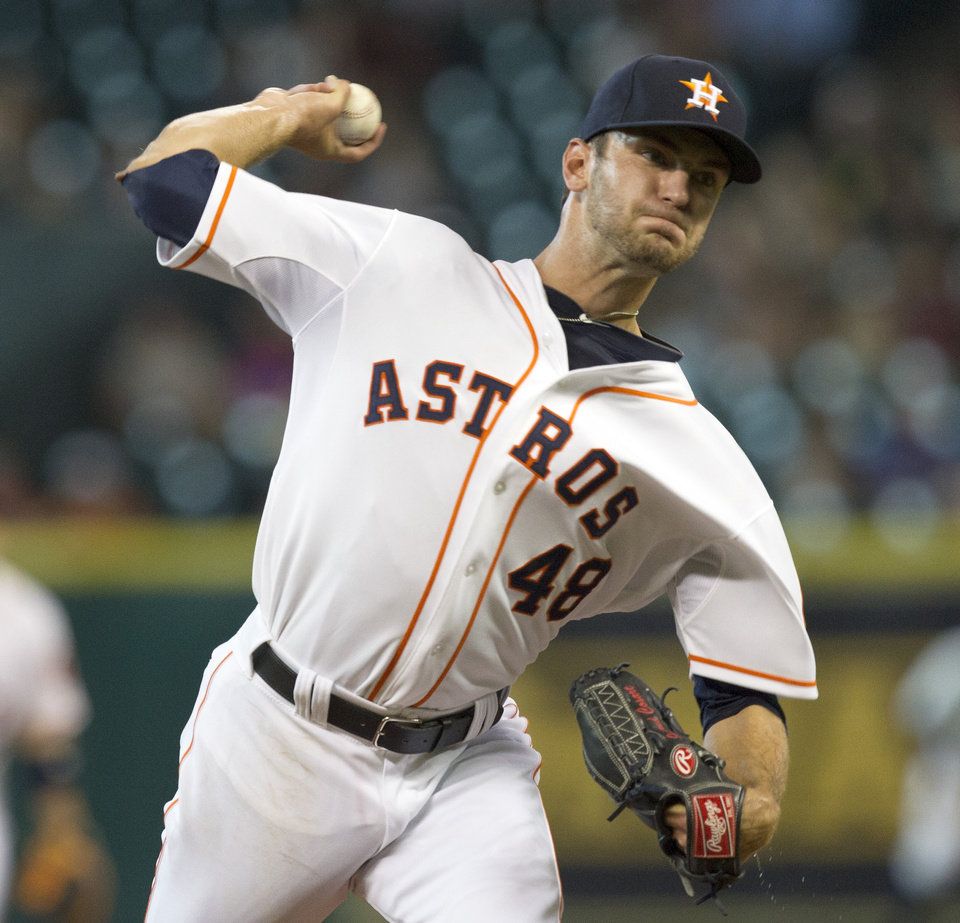 Photo - Houston Astros' Jarred Cosart throws in the first inning of a baseball game against the Oakland Athletics on Tuesday, July 23, 2013, in Houston. (AP Photo/Bob Levey)