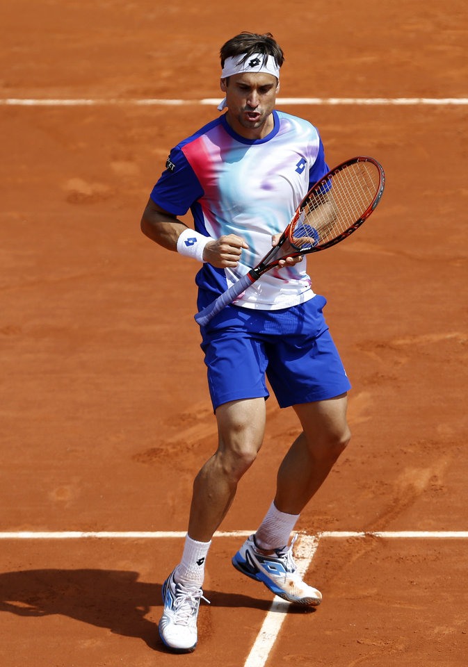 Photo - Spain's David Ferrer reacts as he plays Italy's Andreas Seppi during the third round match of  the French Open tennis tournament at the Roland Garros stadium, in Paris, France, Saturday, May 31, 2014. (AP Photo/Darko Vojinovic)