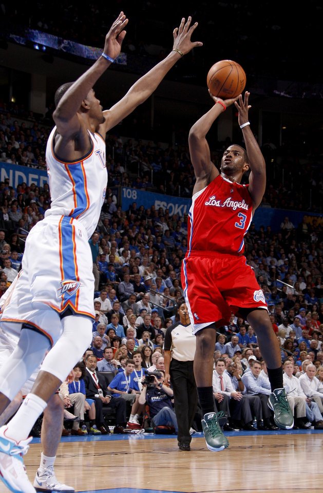 Photo - Los Angeles' Chris Paul (3) puts up a shot beside Oklahoma City's Kevin Durant (35) during the NBA basketball game between the Oklahoma City Thunder and the Los Angeles Clippers at Chesapeake Energy Arena in Oklahoma City, Wednesday, April 11, 2012. Oklahoma City lost 100-98. Photo by Bryan Terry, The Oklahoman