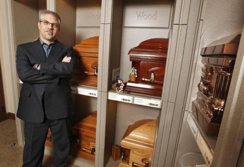 Photo - K. Ray Buchanan, II, owner and funeral director of Buchanan Funeral Service, in the casket display room at Buchanan Funeral Service in Oklahoma City Wednesday, Aug. 31, 2011. Photo by Paul B. Southerland, The Oklahoman ORG XMIT: KOD
