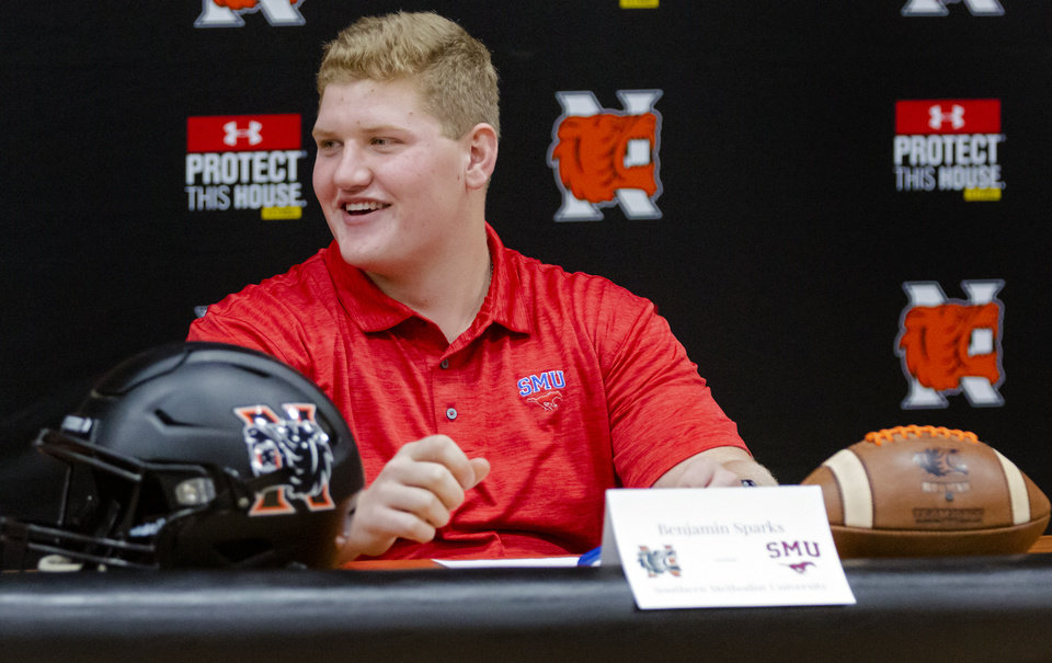 Photo - Southern Methodist University signee Ben Sparks celebrates signing his letter of intent during a national signing day ceremony for football at Norman High School in Norman Okla. on Wednesday, Dec. 18, 2019.   [Chris Landsberger/The Oklahoman]