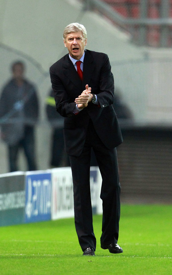 Photo - Arsenal's coach Arsene Wenger reacts during a group B Champions League soccer match against Olympiakos in the port of Piraeus, near Athens, Tuesday, Dec. 4, 2012. (AP Photo/Thanassis Stavrakis)