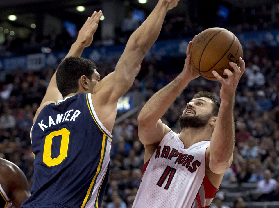 Toronto Raptors forward Linas Kleiza (11) shoots against Utah Jazz center Enes Kanter during the first half of an NBA basketball game in Toronto on Monday, Nov. 12, 2012. (AP Photo/The Canadian Press, Frank Gunn)
