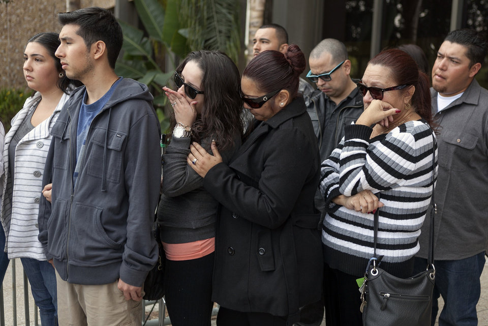 Photo -   Unidentified supporters and family members of victim, 31-year-old Phillip Moreno, express their support for their relative outside court in Torrance, Calif., Tuesday, Nov. 27, 2012. Moreno was struck late Saturday by a car driven by Sherri Wilkins. Los Angeles County prosecutors have filed murder and drunken-driving charges against Wilkins, a substance abuse counselor, who allegedly struck Moreno and drove for more than two miles with the dying victim on the hood of her car. Moreno died at a hospital. (AP Photo/Damian Dovarganes)