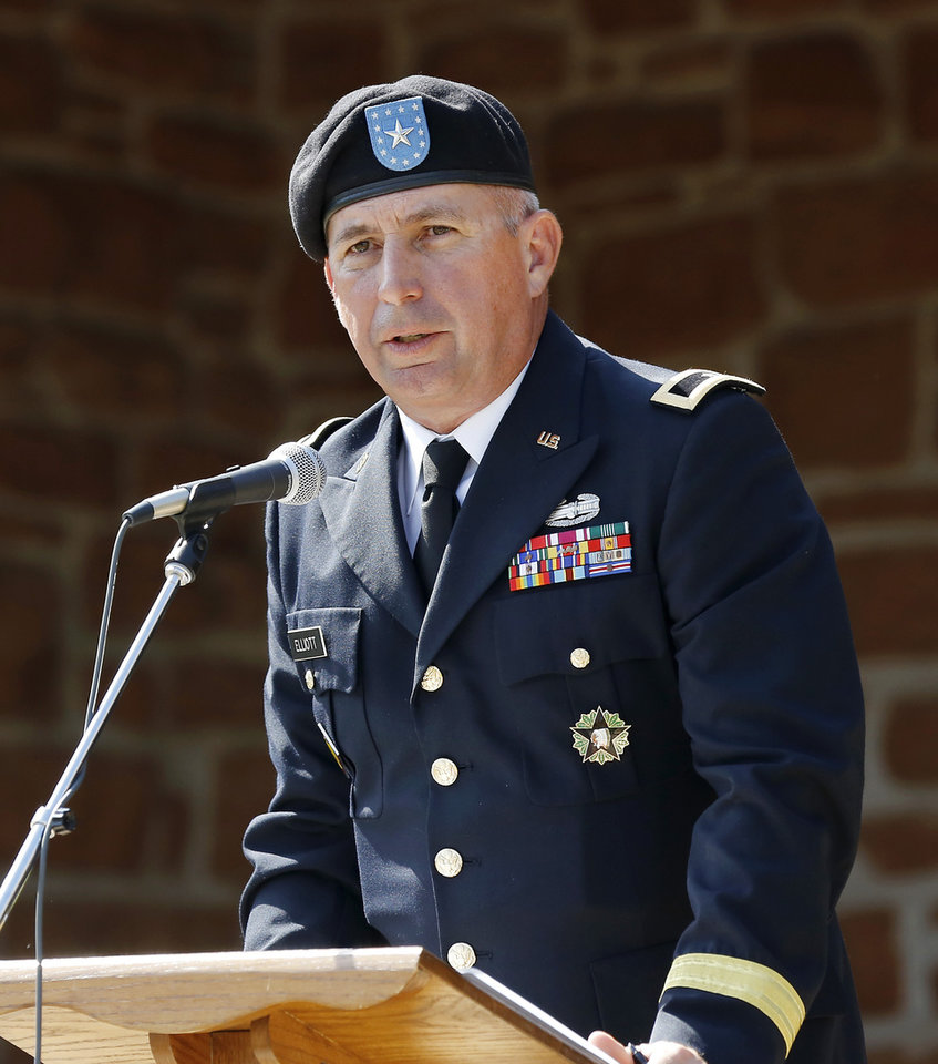 Photo -  Brig. Gen. Steve Elliott delivers the keynote address during the 45th Infantry Division Museum's annual Memorial Day Ceremony on Monday. [Photo by Jim Beckel, The Oklahoman]