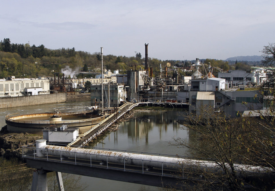 "This photo taken on April 10, 2012, shows the Publisher's Paper Company mill, now closed, on the Willamette River in Oregon City, Ore. The view was photographed from the similar vantage point of an archival 1973 photo taken for the then new Environmental Protection Agency's ""Documerica"" program, 1972-1977, to document subjects of environmental concern. (AP Photo/Don Ryan)"