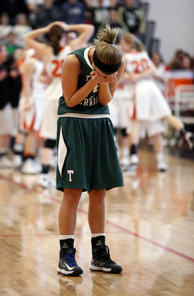 Photo - Thomas Lady Terrier Keela Hamar reacts as her team loses to Fairview in class 2A State Playoff girls basketball at Westmoore High School on Thursday, March 7, 2013, in Moore, Okla. Photo by Steve Sisney, The Oklahoman