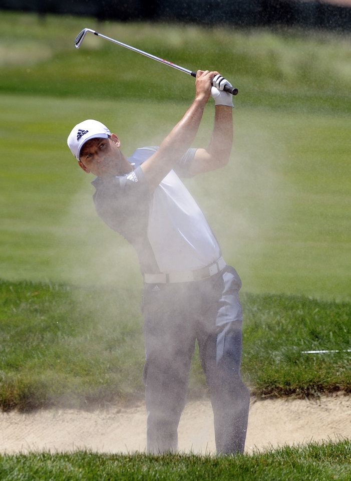 Photo - Sergio Garcia, of Spain, watches his shot after hitting out of a fairway bunker on the seventh hole during the second round of the Travelers Championship golf tournament in Cromwell, Conn., Friday, June 20, 2014. (AP Photo/Fred Beckham)