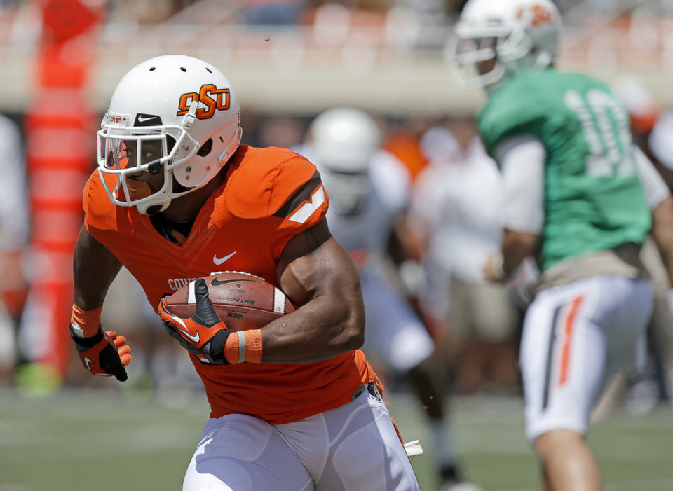 OKLAHOMA STATE UNIVERSITY / COLLEGE FOOTBALL: Oklahoma State's Jeremy Smith runs during OSU's spring football game at Boone Pickens Stadium in Stillwater, Okla., Sat., April 20, 2013. Photo by Bryan Terry, The Oklahoman