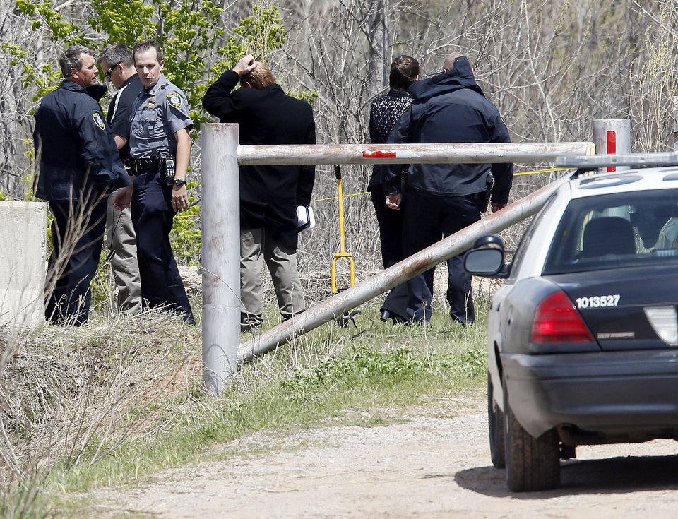 Oklahoma City police investigate a body found Saturday in the Stinchcomb  Wildlife Refuge just north of the end of Morgan Road near the Kilpatrick Turnpike in Oklahoma City. Photo by Nate Billings, The Oklahoman