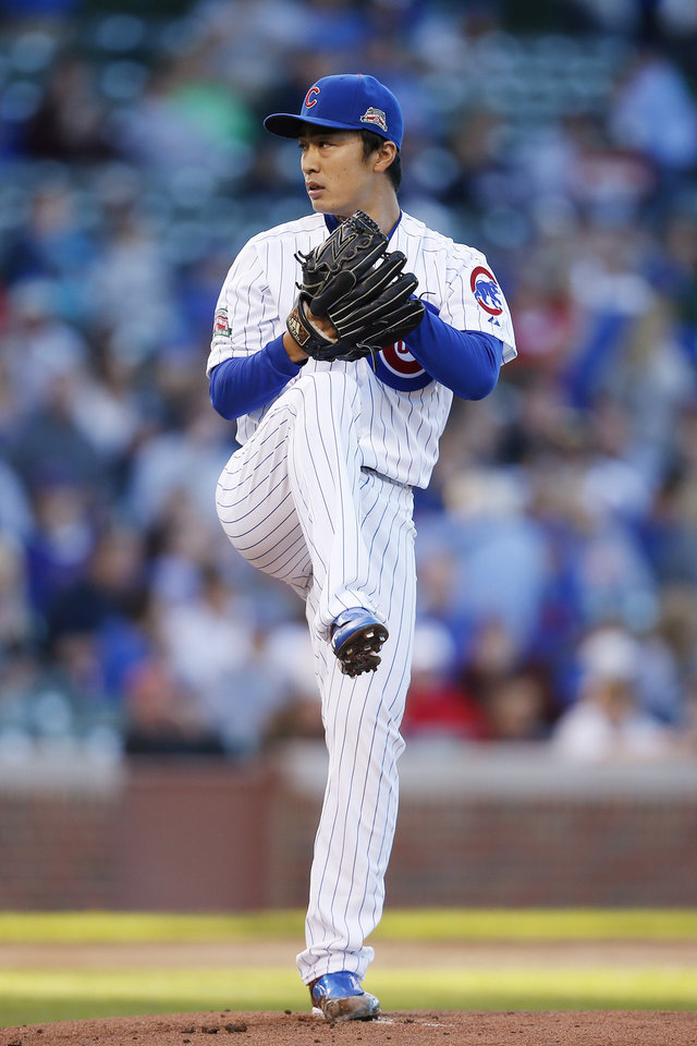 Photo - Chicago Cubs starting pitcher Tsuyoshi Wada delivers against the San Diego Padres during the first inning of a baseball game on Wednesday, July 23, 2014, in Chicago. (AP Photo/Andrew A. Nelles)