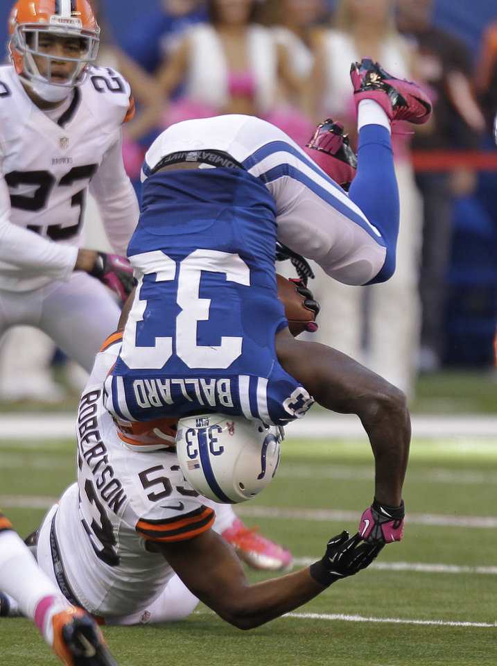 Photo -   Indianapolis Colts' Vick Ballard (33) is upended by Cleveland Browns' Craig Robertson (53) during the second half of an NFL football game Sunday, Oct. 21, 2012, in Indianapolis. (AP Photo/Michael Conroy)